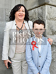 Finn O'Scorlog O'Loinsigh who was confirmed in St Mary's church pictured with mam Valerie. Photo:Colin Bell/pressphotos.ie