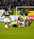 Nederland, Arnhem, 27 januari 2013.Eredivisie.Seizoen 2012-2013.Vitesse-Ajax.Theo Janssen van Vitesse ligt na een botsing met Lasse Schone van Ajax op het veld. Links Patrick van Aanholt van Vitesse.