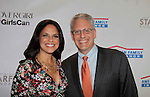 Soledad O'Brien poses with Gary E. Knell (President & CEO of National Geographic at Soledad O'Brien and Brad Raymond Starfish Foundation presents New Orleans to New York City 2014 Gala on July 24, 2014 at Espace, New York City for VIP Cocktail Reception, dinner, entertainment with Grammy Award winning Trumpeteer Irvin Mayfield (also Board president) and the New Orleans Jazz Orchestra. (Photo by Sue Coflin/Max Photos)