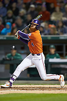 Grayson Byrd (4) of the Clemson Tigers follows through on his swing against the Charlotte 49ers at BB&T BallPark on March 26, 2019 in Charlotte, North Carolina. The Tigers defeated the 49ers 8-5. (Brian Westerholt/Four Seam Images)
