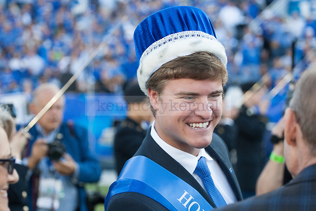 Colby Hall, the 2014 UK Homecoming King, shakes hands with UK president Eli Capilouto during halftime of the Kentucky Wildcats game against the Mississippi State Bulldogs at Commonwealth Stadium on Saturday, October 25, 2014 in Lexington, Ky. Mississippi leads Kentucky 17-10. Photo by Adam Pennavaria | Staff