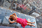 "Jori Boyer, 4, of La Crescent, Minnesota lays down on the newly opened glass balconies ""The Ledge"" at the Skydeck at the Sears Tower in Chicago, Illinois on July 6, 2009."