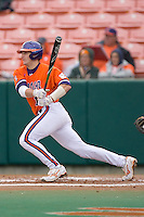 John Nester #17 of the Clemson Tigers follows through on his swing versus the Wake Forest Demon Deacons at Doug Kingsmore stadium March 13, 2009 in Clemson, SC. (Photo by Brian Westerholt / Four Seam Images)