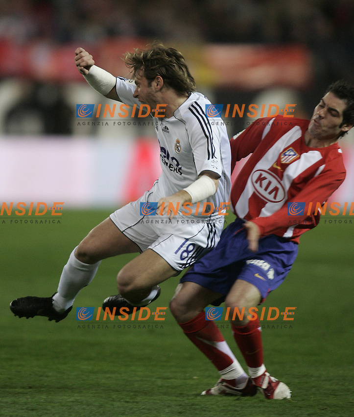 Real Madrid's Antonio Cassano (l) and Atletico de Madrid's Antonio Lopez (r) during  the Spanish League match between Atletico de Madrid and Real Madrid at Vicente Calderon Stadium in Madrid, Saturday February 24 2007. (INSIDE/ALTERPHOTOS/B.echavarri).