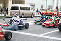 Foreign tourists riding go-karts and wearing Super Mario costumes drive through Ginza on April 14, 2017, Tokyo, Japan. Giant video game company Nintendo is suing the go-kart operator MariCar for using the image of Nintendo character Super Mario without permission, and has filed a lawsuit against MariCar for damages of 10 million JPY to defend its intellectual property rights. (Photo by Rodrigo Reyes Marin/AFLO)