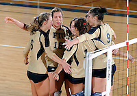 Florida International University women's volleyball players celebrate after the game against the University of South Alabama.  FIU won the match 3-0 on October 30, 2011 at Miami, Florida. .