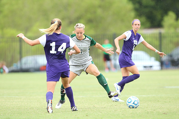 Denton, TX - SEPTEMBER 16: Carly McDowell #4 of the North Texas Mean Green soccer in action against the Texas Christian University Horned Frogs at the Mean Green Village Soccer Field University in Denton on September 16, 2012 in Denton, Texas. (Photo by Rick Yeatts)