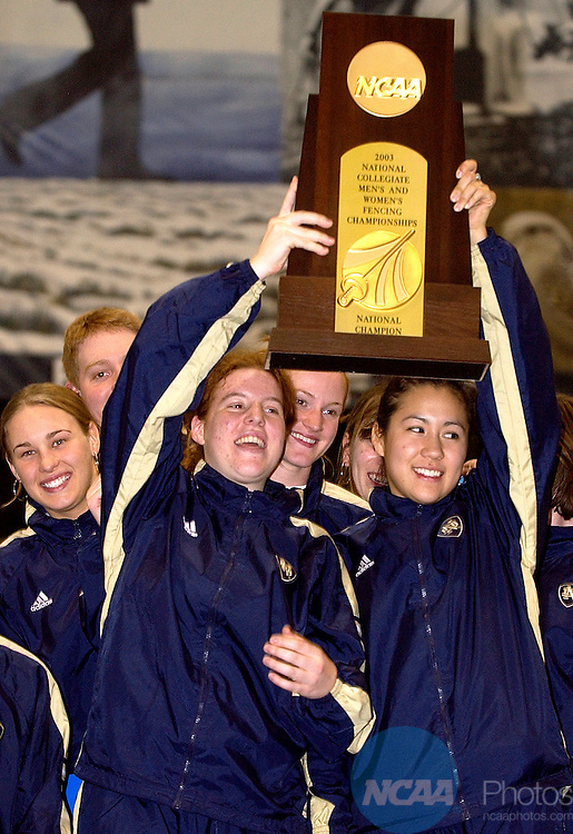 .23 MAR 2002: The Notre Dame team lifts up the championship trophy following the Division 1 Fencing Championships held at the Cadet Field House on the United States Air Force Academy grounds in Colorado Springs, CO. Stephen Nowland/NCAA Photos