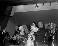Assemblee de L'Union Nationale a Chicoutimi - Mme Barrette, la petite Marie Bergeron qui presenta des fleurs a madame Barrette et Antonio Barrette<br /> , le 9 juin 1960<br /> <br /> Photographe : Photo Moderne - Agence Quebec Presse