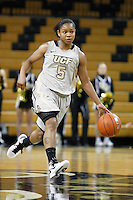 January 27, 2011: Central Florida guard Geneva Carter (5) bring the ball up court during first half womens Conference USA NCAA basketball game action between the Houston Cougars and the Central Florida Knights at the UCF Arena Orlando, Fl.