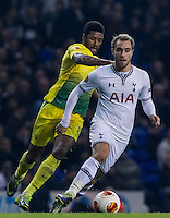 12.12.2013 London, England. Tottenham Hotspur forward Lewis Holtby (14) tracked by Anzhi Makhachkala midfielder Jucilei (8) during the Europa League game between Tottenham Hotspur and Anzhi Makhachkala from White Hart Lane.