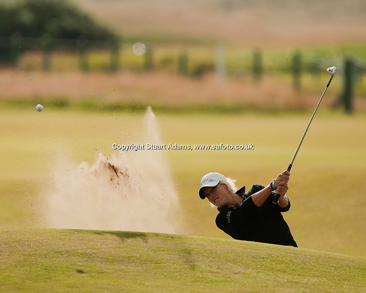 England's Melissa Reid blasts from a bunker at the 6th hole during the first round play of the  Ricoh Woman's British Open to be played over the Championship Links from 28th to 31st July 2011; Picture Stuart Adams, SAFOTO. www.safoto.co.uk; 28th July 2011