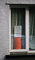A post informing local residents about the next community meeting about terraced houses in Cyfyng Road, which have been either abandoned or evacuated over fears of a landslide in the area in Ystalyfera, Wales, UK. Wednesday 30 August 2017