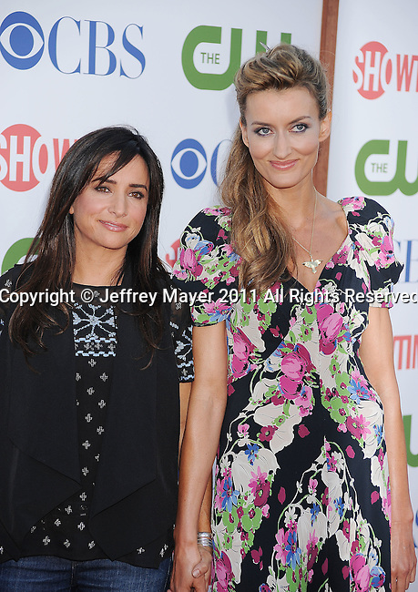 BEVERLY HILLS, CA - AUGUST 03: Pamela Adlon and Natasha McElhone. arrive at the TCA Party for CBS, The CW and Showtime held at The Pagoda on August 3, 2011 in Beverly Hills, California.