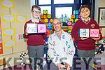 Will McGrath, Padraig O'Chonchuir (Teacher) and Majd Awad enjoying Maths Week 2019 in the Holy Family NS on Thursday.
