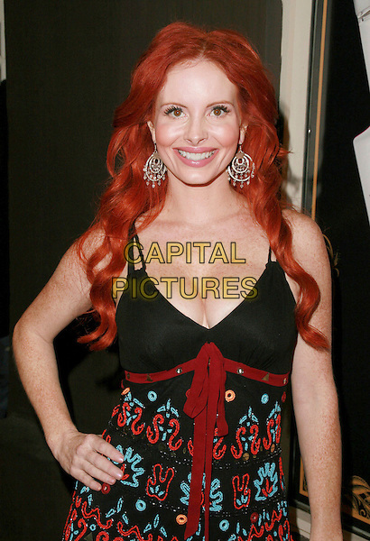 PHOEBE PRICE.Ed Hardy Grand Re-Opening of the Melrose Store, Hollywood, California, USA..October 20th, 2006.Ref: ADM/CH.half length black red pattern dress hand on hip.www.capitalpictures.com.sales@capitalpictures.com.©Charles Harris/AdMedia/Capital Pictures.