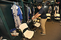 NWA Democrat-Gazette/ANDY SHUPE<br /> Tyler Burson, a Har-Ber graduate and current Northwest Arkansas Community College student, arranges chairs Wednesday, Aug 9, 2017, in the Midland Rockhounds clubhouse while performing his duties as clubhouse assistant for the Northwest Arkansas Naturals at Arvest Ballpark in Springdale.