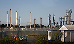 Chimneys of industrial plant chemical works industry at Harwich port, Essex, England