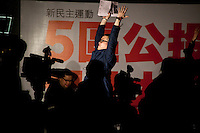"A leader of the new pan-democrats movement is yelling with the crawd ""Power to the people !"" during rally at Chater Garden 01/26/2010, Hong Kong."