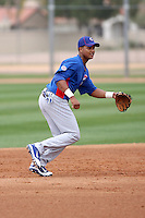 Starlin Castro #13 of the Chicago Cubs participates in infield practice during spring training workouts at the Cubs complex on February 19, 2011  in Mesa, Arizona. .Photo by Bill Mitchell / Four Seam Images.