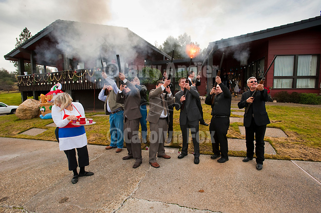 Christmas Day celebration with Jackson's Serbian community...Revelers blast their shotguns in announcing the birth of Christ at the front of the Vukovich home as Lana Vukovich turns away from the volly.