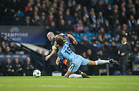 Leroy Sane of Manchester City brings down Scott Brown of Celtic during the UEFA Champions League GROUP match between Manchester City and Celtic at the Etihad Stadium, Manchester, England on 6 December 2016. Photo by Andy Rowland.