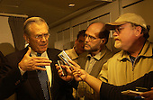 United States Secretary of Defense Donald H. Rumsfeld answers the question of press traveling with him prior to arriving in Iraq on September 3, 2003.                           <br /> Mandatory Credit: Andy Dunaway / DoD via CNP