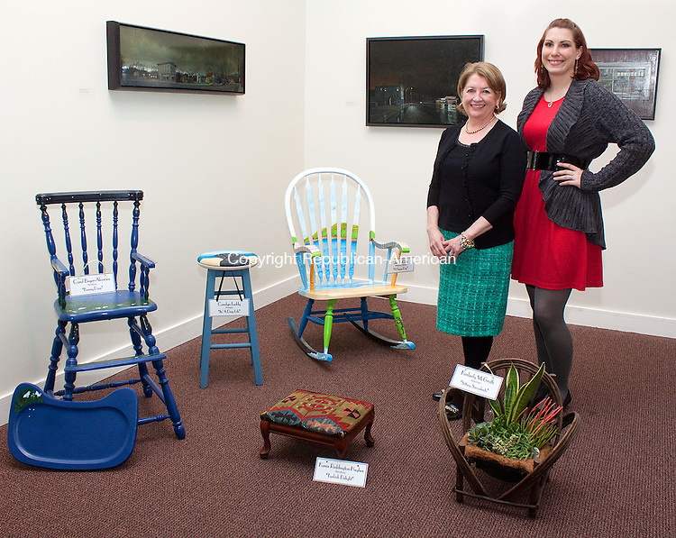 "WATERBURY CT-APRIL 11 NEW_0114DA02-Tara Shea President Board of Directors at Waterbury Youth Services left, and Stephanie Harris Marketing Director of the Mattatuck Museum stand next to designer chairs that will be part of Take A Seat, ""Chair"" and Auction & Reception along with 20 other local artist creative chairs held at the Country Club of Waterbury on Friday April 26th from 5:30 p.m.- 8:30 p.m. Proceeds will support Waterbury Youth Service System. For tickets or information contact WYSS at 203-573-0264 or visit www.waterburyyouthservices.org..Darlene Douty Republican American"