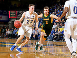 BROOKINGS, SD - FEBRUARY 1: Reed Tellinghuisen #23 from South Dakota State University drives to the basket past Paul Miller #2 from North Dakota State University during their game Thursday at Frost Arena in Brookings. (Photo by Dave Eggen/Inertia)