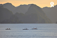 Three canoes at sunset, Halong Bay, Vietnam (Licence this image exclusively with Getty: http://www.gettyimages.com/detail/85985764 )