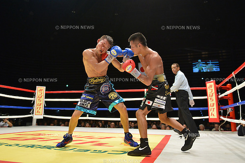 (L-R) Daiki Kaneko, Takashi Uchiyama (JPN),<br /> DECEMBER 31, 2013 - Boxing :<br /> Takashi Uchiyama of Japan hits Daiki Kaneko of Japan during the ninth round of the WBA super featherweight title bout at Ota-City General Gymnasium in Tokyo, Japan. (Photo by Hiroaki Yamaguchi/AFLO)