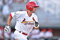 Johnson City Cardinals third baseman Paul DeJong (21) runs to first during a game against the Kingsport Mets on June 25, 2015 in Johnson City, Tennessee. The Mets defeated the Cardinals 10-8 (Tony Farlow/Four Seam Images)