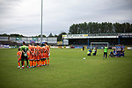 The two teams posing for photographs on the pitch before Coleraine (in blue) played Spartak Subotica of Serbia in a Europa League Qualifying First Round second leg at the Showgrounds, Coleraine. The hosts from Northern Ireland had drawn the away leg 1-1 the previous week, however, the visitors won the return leg 2-0 to progress to face Sparta Prague in the next round, watched by a sell-out crowd of 1700.