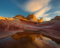 Beautiful striated sandstone reflected in a rain pool in this remote region of the Arizona desert.
