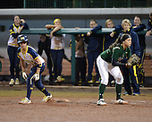 Michigan Wolverines Softball shortstop Sierra Romero (32) leads off first behind Stephanie Medina during a game against the University of South Florida Bulls on February 8, 2014 at the USF Softball Stadium in Tampa, Florida.  Michigan defeated USF 3-2.  (Copyright Mike Janes Photography)