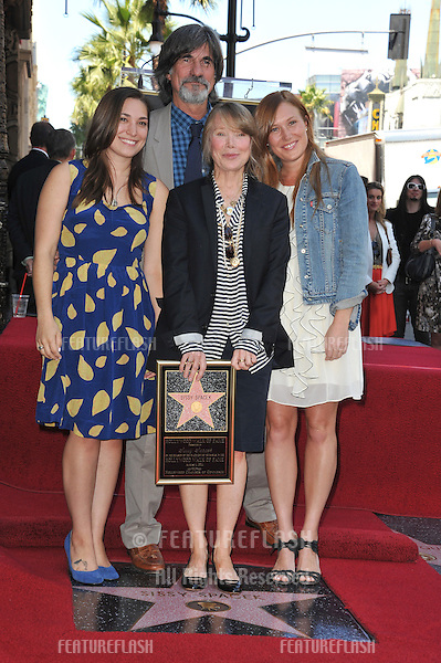 Sissy Spacek with husband Jack Fisk & daughters Schuyler Fisk & Madison Fisk (left) on Hollywood Boulevard where she was honored with the 2,443rd star on the Hollywood Walk of Fame..August 1, 2011  Los Angeles, CA.Picture: Paul Smith / Featureflash