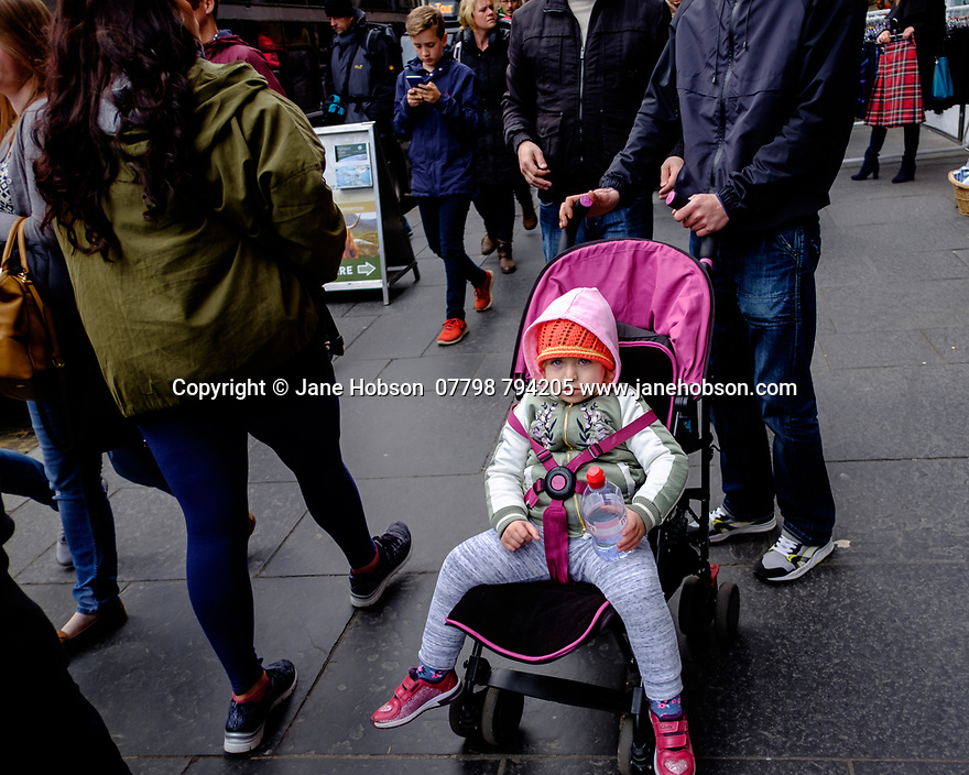 Edinburgh, UK. 15.04.2017. Small child in a pushchair, Royal Mile. Photograph © Jane Hobson.