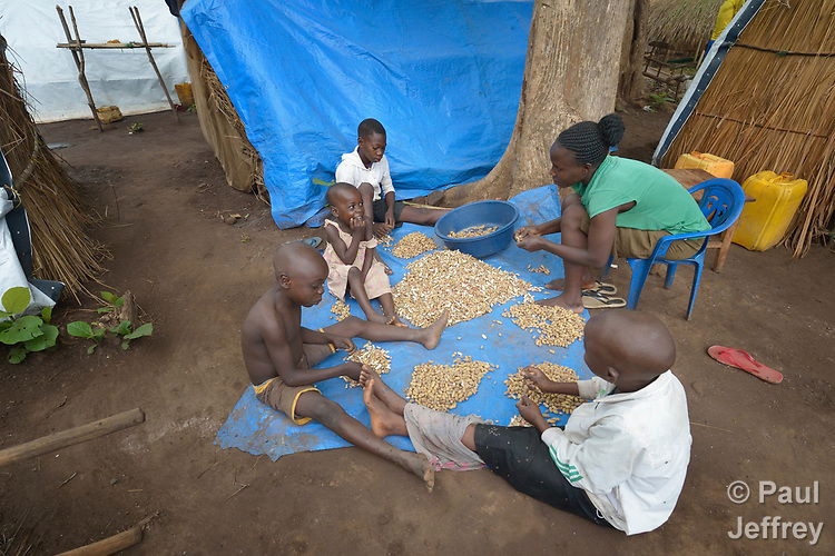 Mariana David and her children shell peanuts in a camp for more than 5,000 displaced people in Riimenze, in South Sudan's Gbudwe State, what was formerly Western Equatoria. Families here were displaced at the beginning of 2017, as fighting between government soldiers and rebels escalated.<br /> <br /> Two Catholic groups, Caritas Austria and Solidarity with South Sudan, have played key roles in assuring that the displaced families here have food, shelter and water.