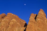 Sandstone fins against blue sky w/moon-Arches National Park, Utah