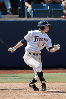 Keegan Dale #5 of the Cal State Fullerton Titans bats against the TCU Horned Frogs at Goodwin Field on February 26, 2012 in Fullerton,California. Fullerton defeated TCU 11-10.(Larry Goren/Four Seam Images)