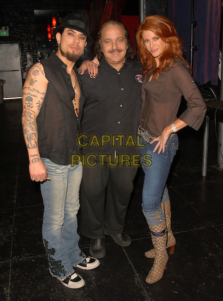 DAVE NAVARRO, RON JEREMY & ANGIE EVERHART.At Dave Navarro's Spread Entertainment weekly internet show,episode 3 on Maniatv.com held at The Dragonfly in Hollywood, California, USA..May 31st, 2007.full length brown shirt black hat tattoos jeans denim beige boots rolled turned up.CAP/DVS.©Debbie VanStory/Capital Pictures