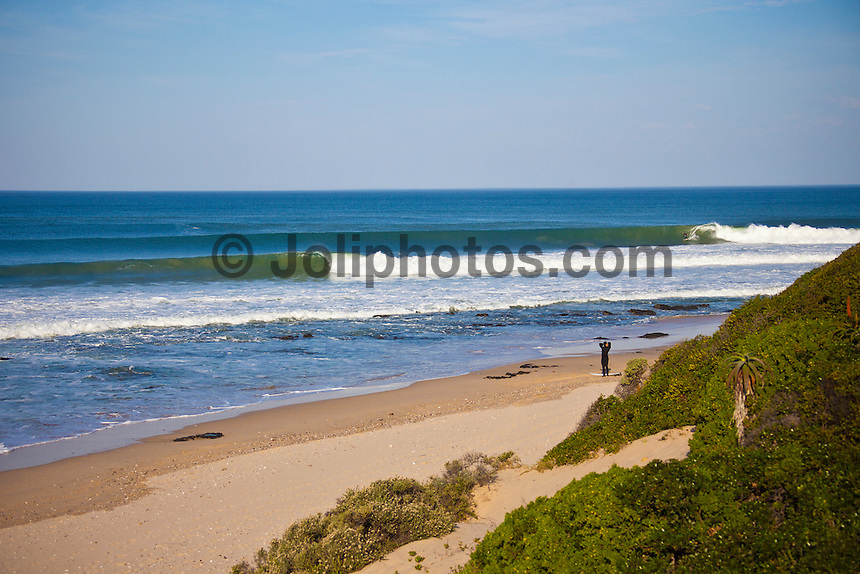 Friday July 9, 2010. Free surfing at Jeffreys Bay, Eastern Cape, South Africa.  The swell is in the 5'-6' range with a howling north west devil wind. Photo: joliphotos.com