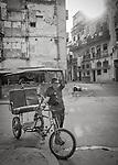 Havana, Cuba: Bicitaxi in a street scene, Old Havana
