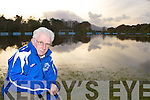 Don O'Donoghue surveys the flooded Killarney Athletic soccer field Friday morning which flooded when the river running alongside the field burst its banks Thursday night