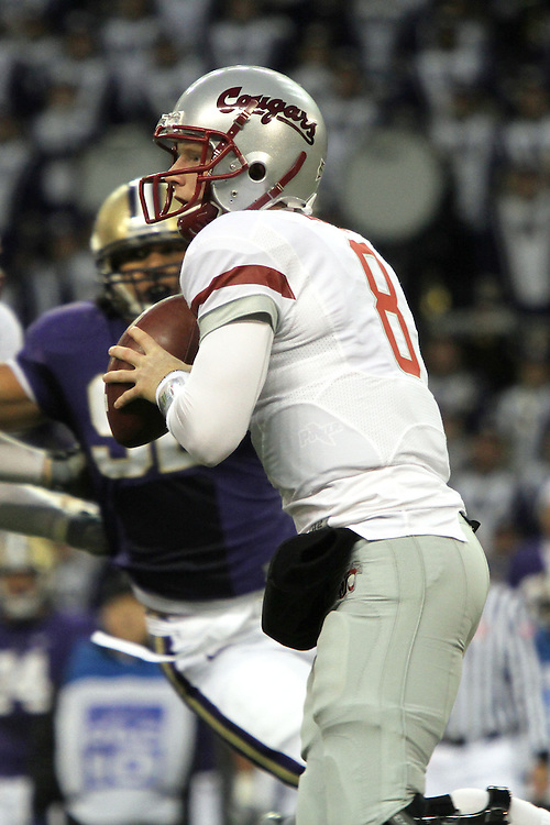 "Marshall Lobbestael (#8), Washington State quarterback, looks down field for an open receiver during the Cougars Pac-10 conference ""Apple Cup"" showdown with arch-rival Washington at Husky Stadium in Seattle, Washington, on November 28, 2009.  The Cougars lost to the Huskies in the game, 30-0."