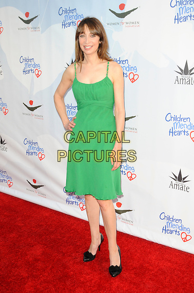 "ILLEANA DOUGLAS .arriving at Children Mending Hearts' 3rd Annual ""Peace Please"" Gala at the Music Box @ Fonda in Hollywood, California, USA, April 16th, 2010.  .arrivals full length green sleeveless dress hand on hip black shoes .CAP/ROT.©Lee Roth/Capital Pictures"