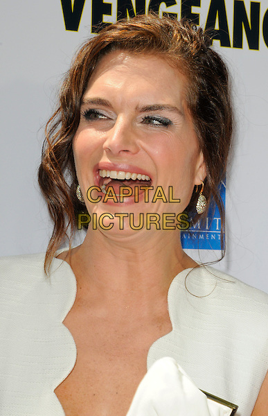 "BROOKE SHIELDS.The Los Angeles premiere of ""Furry Vengeance"" at Mann Bruin Theatre in Westwood, California, USA..April 18th, 2010 .headshot portrait hair up earrings silver white scallop edge edged wavy trim  mouth open smiling funny .CAP/ROT.©Lee Roth/Capital Pictures"