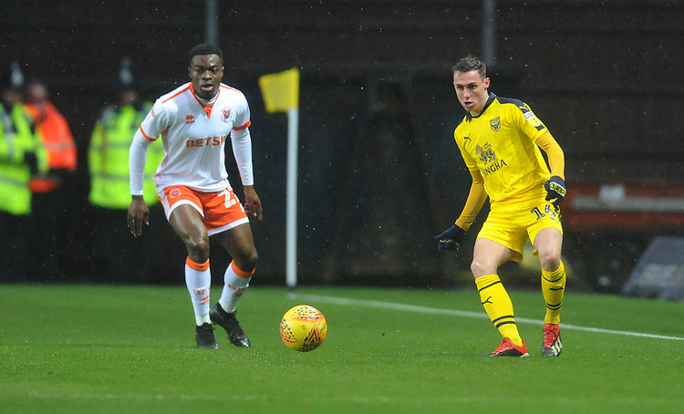 Oxford United's Gavin Whyte under pressure from Blackpool's Marc Bola<br /> <br /> Photographer Kevin Barnes/CameraSport<br /> <br /> The EFL Sky Bet League One - Oxford United v Blackpool - Saturday 15th December 2018 - Kassam Stadium - Oxford<br /> <br /> World Copyright © 2018 CameraSport. All rights reserved. 43 Linden Ave. Countesthorpe. Leicester. England. LE8 5PG - Tel: +44 (0) 116 277 4147 - admin@camerasport.com - www.camerasport.com
