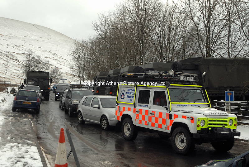 SNOW WEATHER WALES<br /> Pictured: A Brecon Mountain Rescue Team 4x4 navigates its way through heavy traffic in Storey Arms in the Brecon Beacons, Wales, UK. Friday 13 January 2017<br /> Re: Heavy snow affects parts of the UK