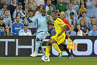 Columbus Crew defender Julius James (26) puts his body between the ball and Sporting KC forward C.J Sapong... Sporting Kansas City defeat Columbus Crew 2-1 at LIVESTRONG Sporting Park, Kansas City, Kansas.